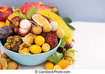 Exotic fruits in a blue bowl