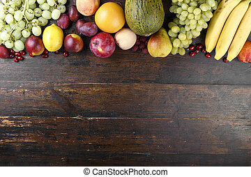 exotic fruits on a wooden background - fruit background with...