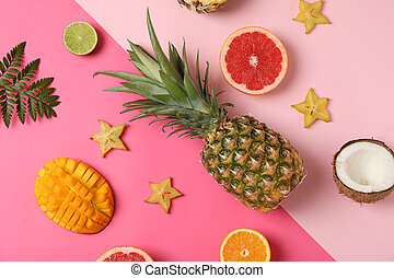 Exotic fruits on two tone background, top view