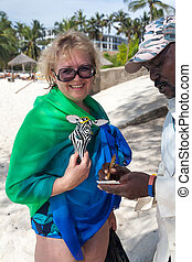 Exotic handmade souvenirs from Africa. Shopping on the beach Kenya