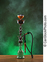 Exotic hookah with the fruit on the top over vintage background