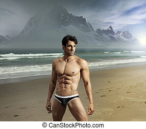 Exotic man - Muscular fit sexy guy on remote scenic beach...