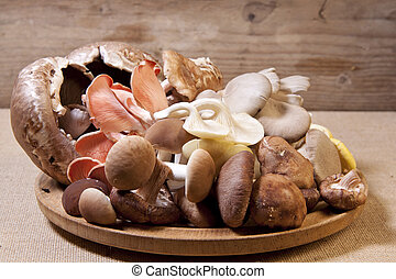 Exotic mushrooms. - A pile of raw exotic mushrooms on a...