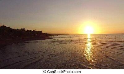 Exotic, romantic view of sunrise over sea shore. Drone...