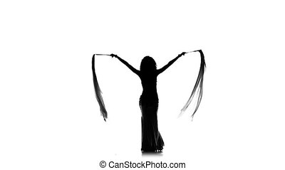 Exotic, slim belly dancer woman continue dance, uses two fans, on white, slow motion, silhouette