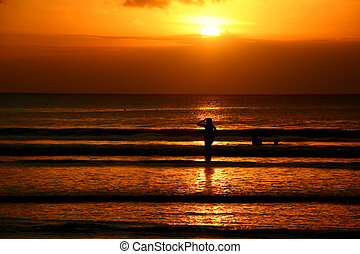Exotic - Woman rising from the water in Kuta Beach, Bali.