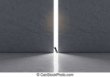Expanding the boundaries of consciousness concept with man trying to move huge concrete wall to let in the light.