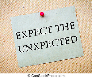 Expect the Unexpected Message. Recycled paper note pinned on cork board. Concept Image