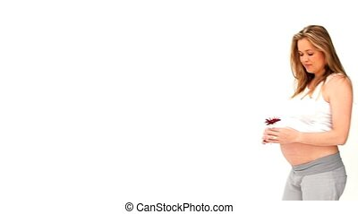Expecting woman holding a red flower isolated on a white...