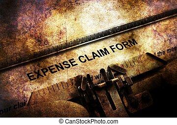 Expense claim form on vintage typewriter
