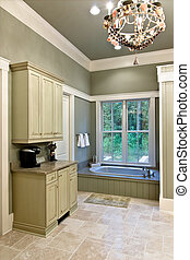 expensive bathroom with tub and cabinets