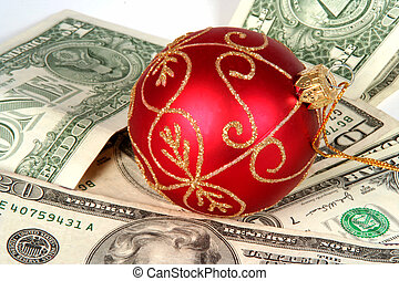 Expensive Christmas - Red Christmas orniment on a pile of...