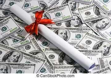 Expensive Education - A rolled up certificate lay over...