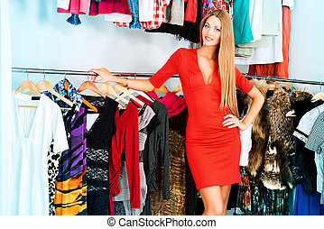 expensive lifestyle - Fashionable girl shopping in a store.