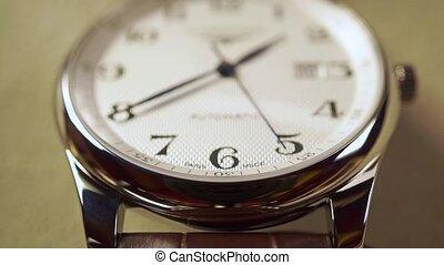 Expensive wrist watch vertical close up shot