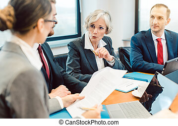 Experienced attorney with her team of professionals working