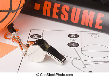 Equipment and a resume of a very experienced basketball coach.