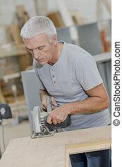 Experienced carpenter using a circular saw