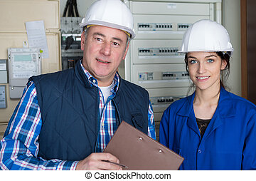 experienced engineer with his young female trainee