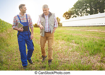 Experienced farmers on the field
