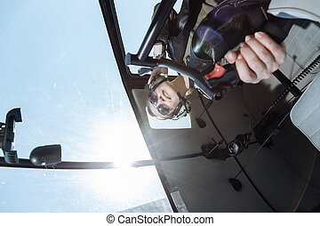 Experienced female pilot doing a loop