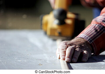 Experienced Hands Construction - The hands of an experienced...