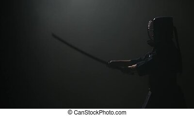 Experienced Kendo guru practicing martial art with the...