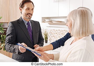 Experienced lawyer giving consultation to elderly couple about big purchase