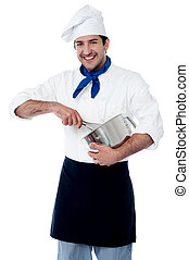 Experienced male chef using egg beater