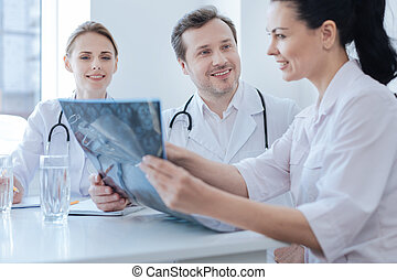 Experienced neurosurgeon helping new colleagues at the...