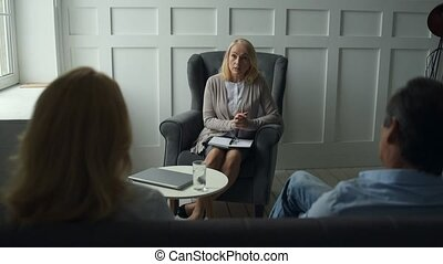 Experienced psychiatrist consulting a couple - Psychiatric...