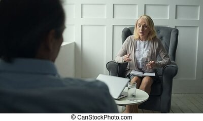 Experienced psychiatrist consulting her client