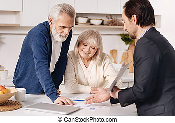 Experienced real estate agent recommending the house to elderly couple