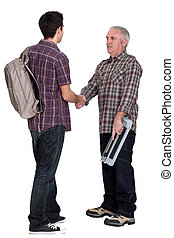 Experienced tradesman welcoming his new apprentice