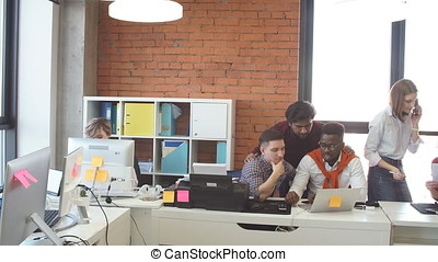 Experienced web designers are working in the modern office...