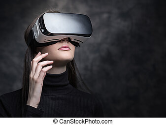 Experiencing virtual reality - Young woman wearing a VR...