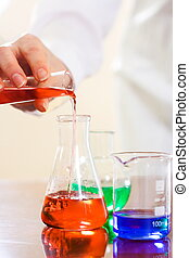 Experiment - Analysing process in laboratory: woman\'s hand...