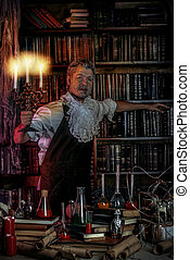 experiment - Crazy old man medieval scientist working in his...