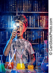 experimenter - A boy doing experiments in the laboratory. ...