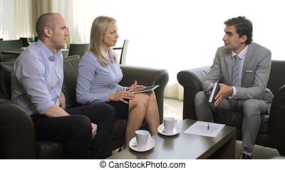 Expert Consultation - Man consulting couple of clients