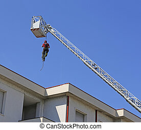 expert firefighter down with the rope in the building during a fire alarm