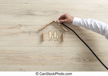 Expert holding a stethoscope on a family house