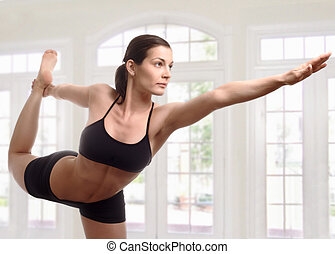 Expert yoga pose - Young woman is doing an expert yoga...