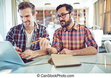 Explaining data - Asian businessman explaining data to his...