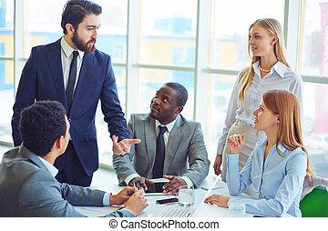 Explaining idea - Elegant businessman explaining his idea to...