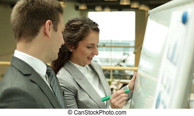 Explaining idea - Businesswoman explaining something to her...