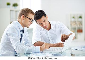 Explaining idea - Portrait of smart businessmen discussing...