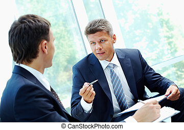 Explaining - Image of smart boss explaining to colleague...