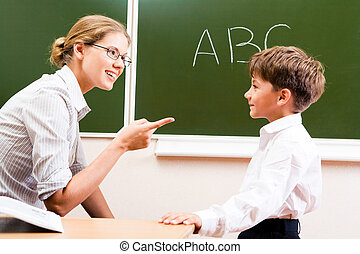Explaining rules - Portrait of confident teacher explaining...