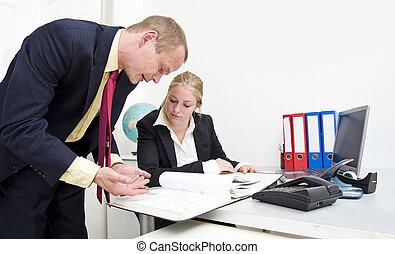 Explaining - Senior colleague explaining something from a...